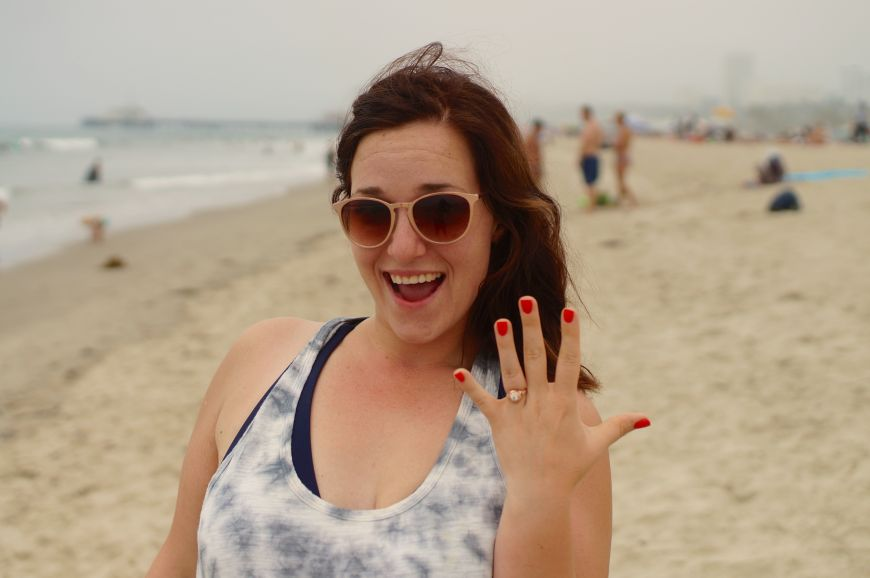 She said yes! Engagement ring, on the beach