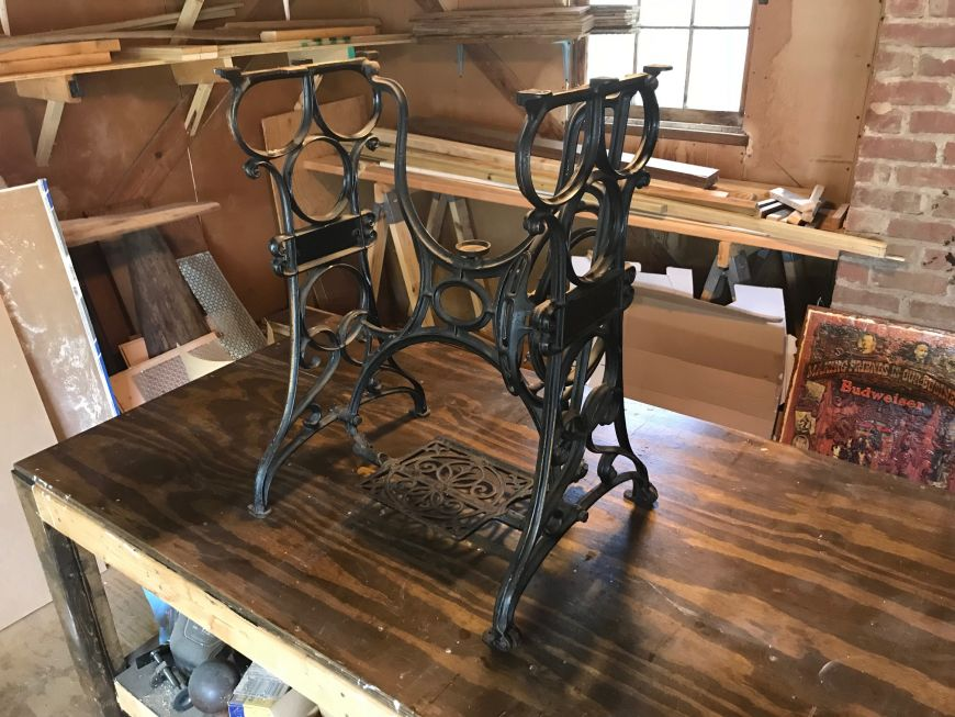 cast iron legs from a sewing machine
